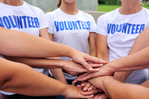 Volunteer group joining hands